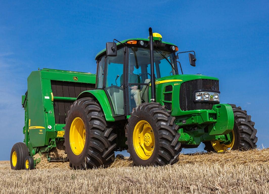 Trator 6100J. Combinação perfeita entre eficiência e versatilidade.